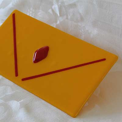 Gold cheese plate with red diamond alt